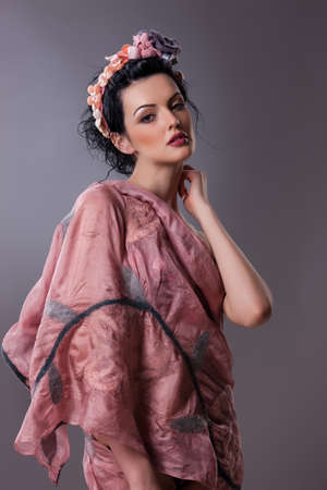 Young beautiful brunette woman in handmade fashionable clothing
