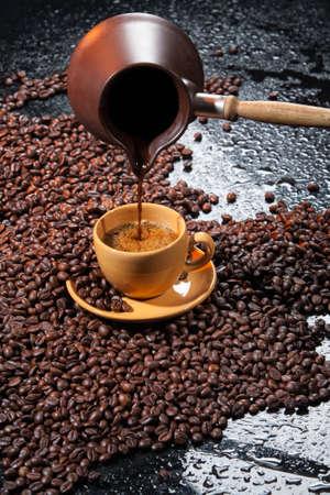 Coffee and coffee beans ona studio background