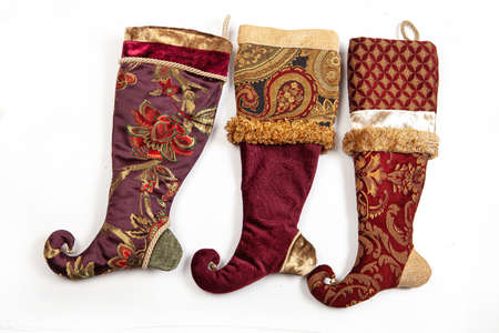 Three christmas sock on a white isolated background