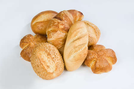 Different kinds of pastry on an isolated studio background