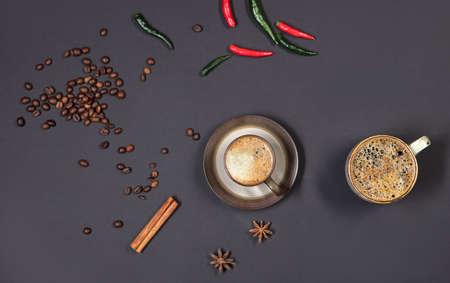 Cup of coffee and pepper on a black background