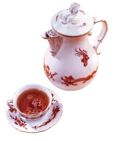 Cup of tea and tea pot on an isolated studio background