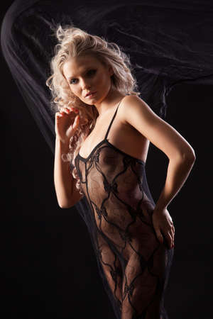 Young beautiful woman in a lingerie on a black studio background Stock fotó