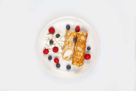Pancakes and berries on a plate on an isolated background Stock fotó