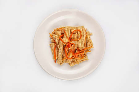 Vegetable salad with marinade on a plate on isolated studio background