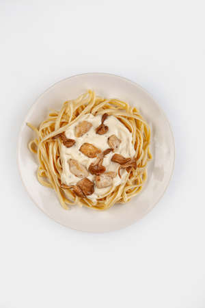Spaghetti and sauce on a plate on isolated studio background Stock fotó