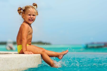happy cute girl have a fun in pool against turquoise water of the ocean Stock Photo - 7874366