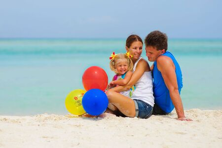 happy family have a party with balloons on tropical beach