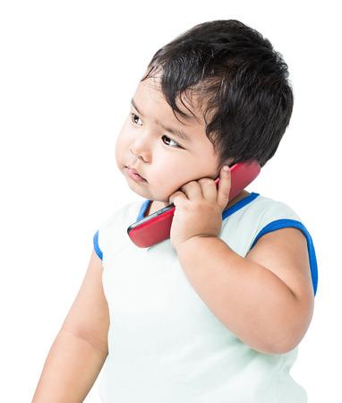 talkative: Cute Asian Boy Using a Mobile Phone Stock Photo