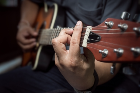 guitar player: Closeup of fingers from playing acoustic guitar