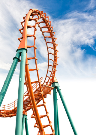 Rail of the roller coaster on blue sky background photo