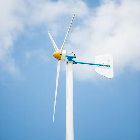 electricity generator: Wind turbine electricity generator on blue sky Stock Photo