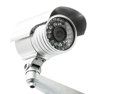 monitoring system: Closeup of security camera head isolated on white