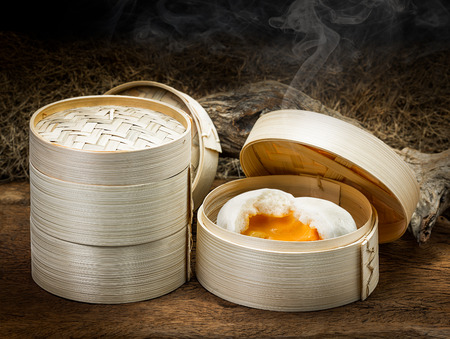 Chinese steamed bun and sweet creamy stuff in bamboo ware
