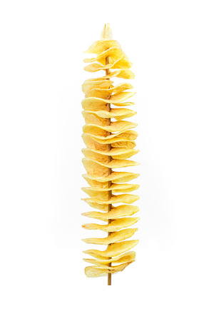 Fry twist slice potato insert on bamboo isolated on white Foto de archivo