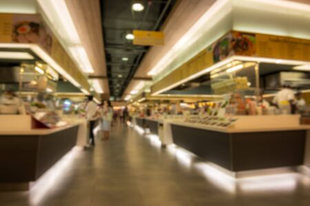 food court: Abstract blur food court in department store for background material