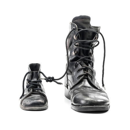 Combat boots for adult and kid in concept of father and son in family isolated on white with clipping path