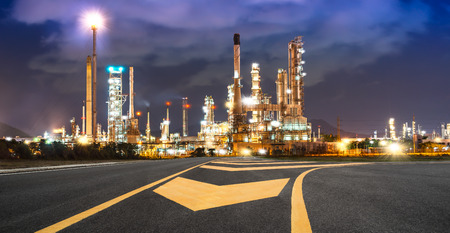 Road to the oil refiner on blue sky in sunset time Stock Photo