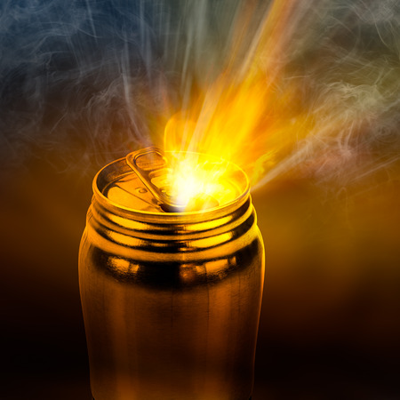 aluminium can: Beam of fire blaze in the act of burst out from internal golden aluminium can