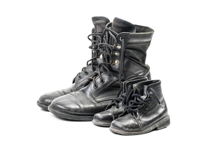 combat boots: Dirty combat boots for adult and kid isolated on white background with clipping path Stock Photo