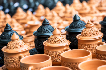 plentifully: Thai art engrave pattern on the heap of traditional pottery in produce factory