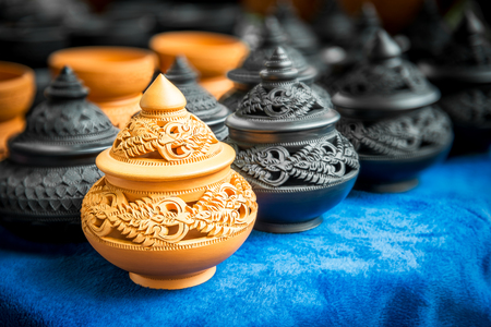 enormously: Thai art engrave pattern on the traditional pottery