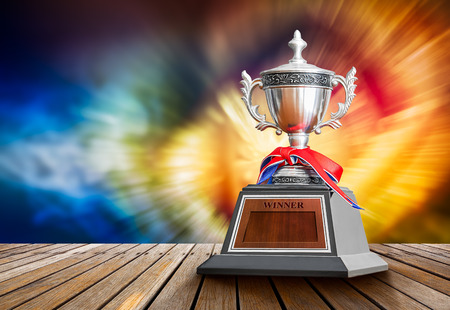 sports trophy: Winner trophy on wooden table for the champion of sport competition Stock Photo
