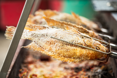 revolve: Salted grilled fish on the revolve steel cooking stove Stock Photo