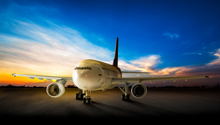 Parking business airplane at the airport runway in the beautiful sunset background
