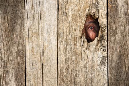 eye hole: Eye of vampire in wooden hole in concept of secretly dangerous