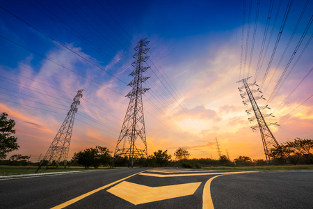 Hight voltage electricity pylon system on sunrise background
