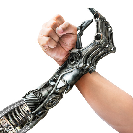 Human and robot hand in action of arm wrestling isolated on white background
