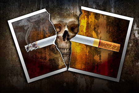 rend: Damage tear a burning cigarette photo paper on the human skull background in concept of stop and no smoking because of bring to die