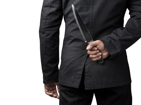 businessman hold on knife in concept of business betray isolated on white