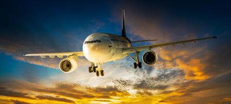 overcast: Airplane for transportation flying on the sunset sky