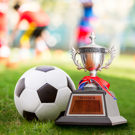 Winner trophy and soccer ball at the competition sport court Stock Photo