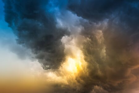 Soft and motion blur rain cloud before the storm in sunset time