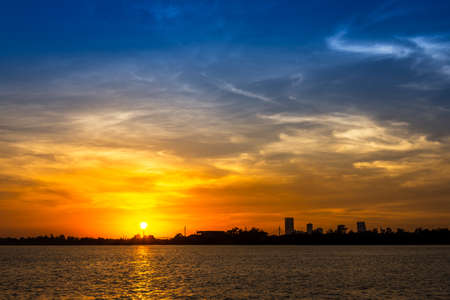 gloaming: Soft and motion blur cloud on blue sky at riverside in sunset time Stock Photo