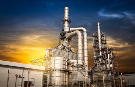 destilacion: Structure of the oil refinery building on sunset background