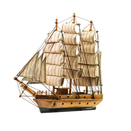 Model of the wooden antique schooner isolated on white background Stock Photo