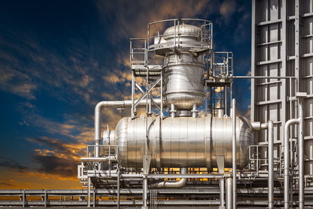 Architecture of powerhouse pipe system on sunset background Stock Photo