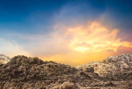 Pile of dirt and soil on sunset background Stock Photo