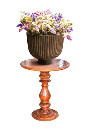 vintage furniture: Flower for decoration in wooden vase on table isolated on white