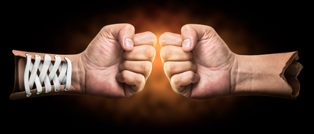 Creative of boxing hand on dark background with clipping path Stock Photo