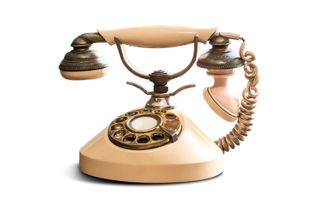 Old vintage telephone isolated on white background
