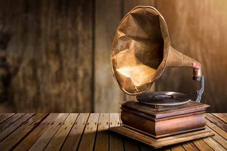 Antique gramophone vinyl record player on wooden table