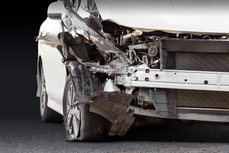 Damaged crash car from accident and ground isolated on black background with clipping path 스톡 콘텐츠