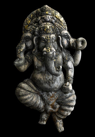 Ancient Ganesha statue isolated on black background with clipping path