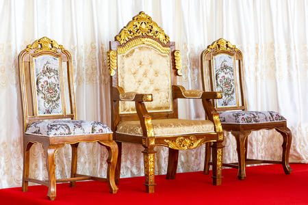 Ancient luxury golden chair on red carpet floor and curtain background 写真素材