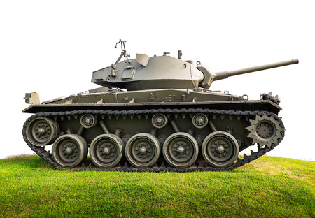 Heavy armor military tank attacking on grassland isolated on white background with clipping path